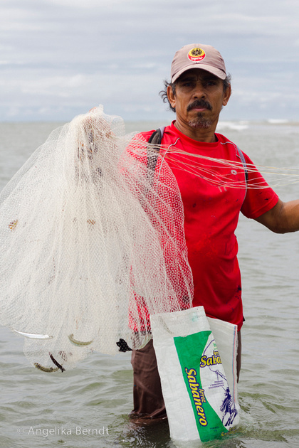 Fisherman fishing at the Pacific coast in Costa Rica