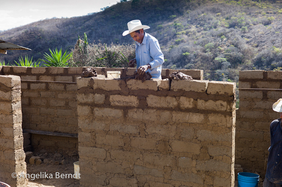 Building a house with adobe bricks