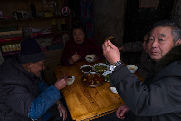 Chinese family having lunch in their home